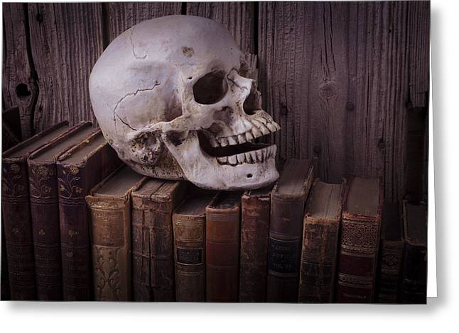 Library Greeting Cards - Skull on old books Greeting Card by Garry Gay