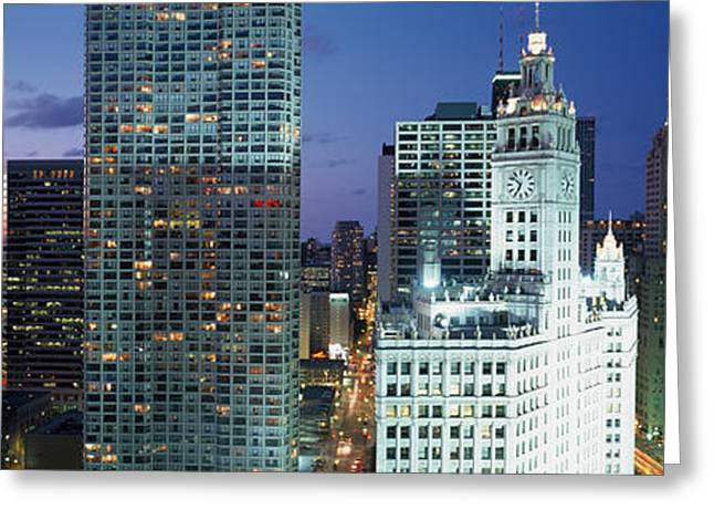 Night Scenes Greeting Cards - Skyscraper Lit Up At Night In A City Greeting Card by Panoramic Images