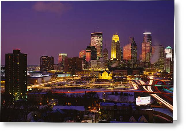 Hennepin Greeting Cards - Skyscrapers Lit Up At Dusk Greeting Card by Panoramic Images