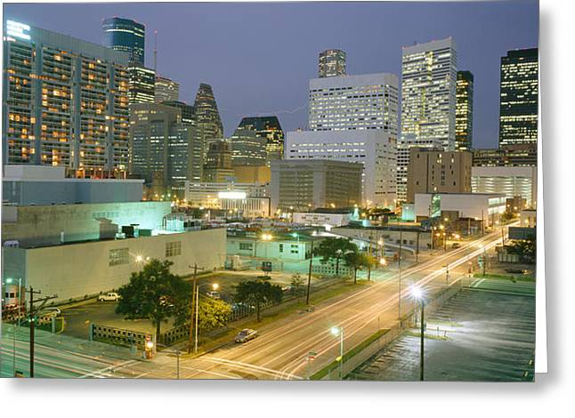 Headlight Greeting Cards - Skyscrapers Lit Up At Night, Houston Greeting Card by Panoramic Images