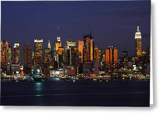 Locations Greeting Cards - Skyscrapers Lit Up At Night In A City Greeting Card by Panoramic Images