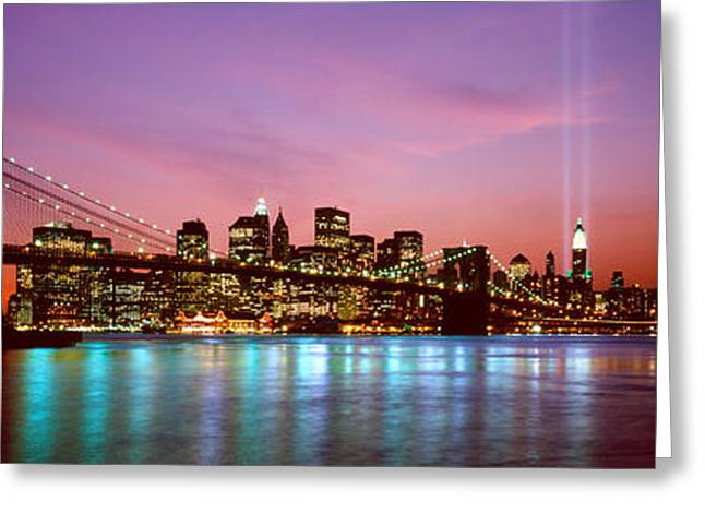 Reflections In River Greeting Cards - Skyscrapers Lit Up At Night, World Greeting Card by Panoramic Images