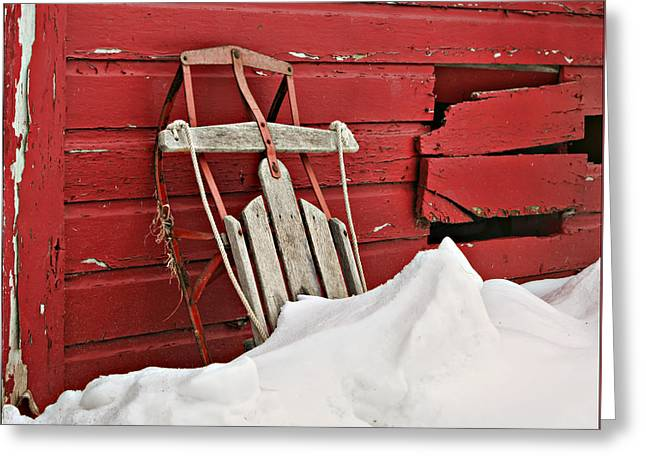 Snow Drifts Greeting Cards - Sled on Red Greeting Card by Nikolyn McDonald