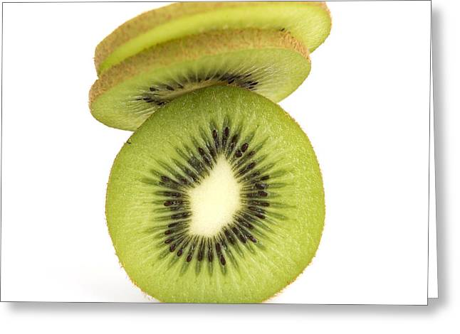 Slices Greeting Cards - Sliced kiwis Greeting Card by Bernard Jaubert