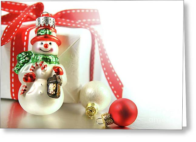 Snowman. Greeting Cards - Small christmas ornament with gift Greeting Card by Sandra Cunningham