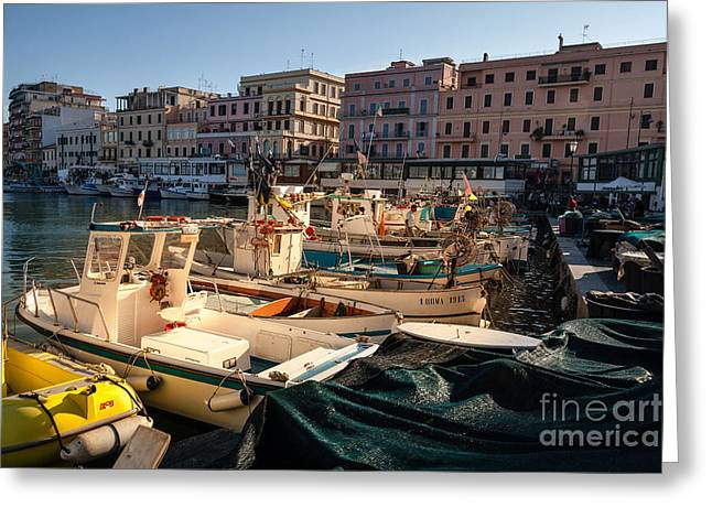 Working Boats Greeting Cards - small working fishing boats moored stern first in Anzio harbour Greeting Card by Peter Noyce