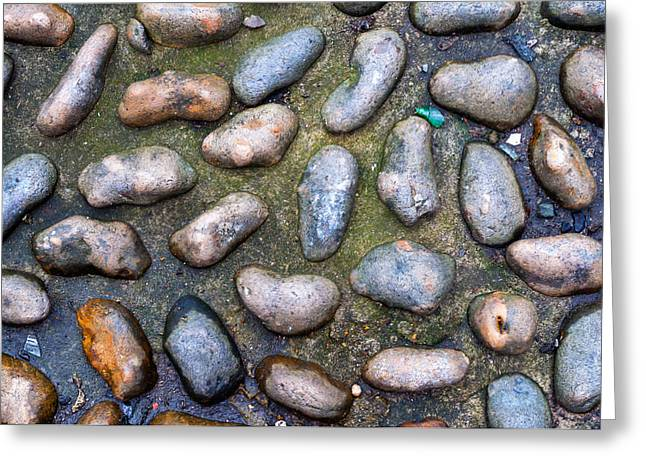 Unclean Greeting Cards - Smooth Stones in Cement Greeting Card by Chay Bewley