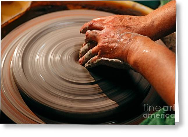 Pottery Wheel Greeting Cards - Smoothing Clay Greeting Card by James L. Amos