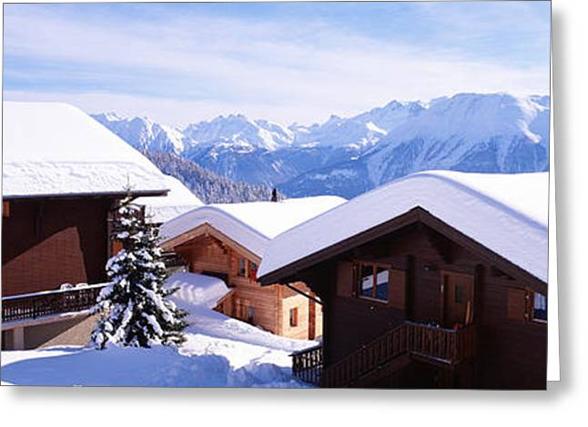 Chalet Greeting Cards - Snow Covered Chapel And Chalets Swiss Greeting Card by Panoramic Images