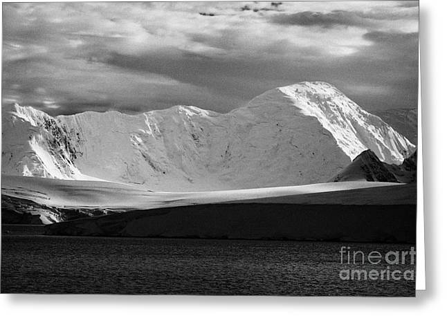 Snow-covered Landscape Greeting Cards - snow covered landscape of anvers island and neumayer channel Antarctica Greeting Card by Joe Fox