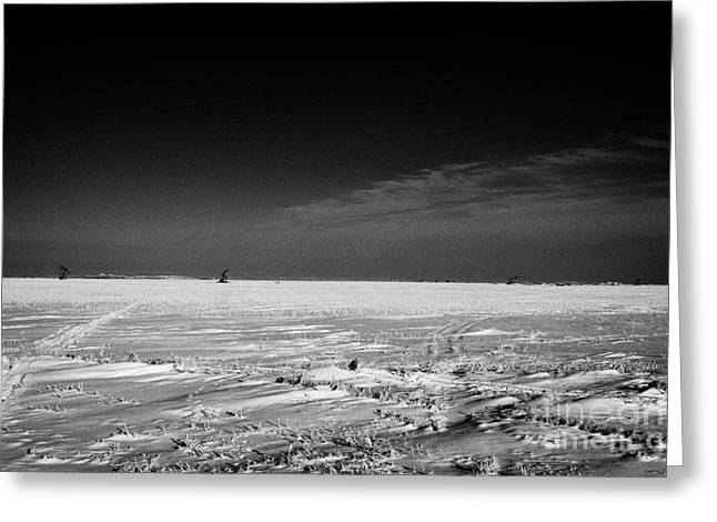 Beam Pump Greeting Cards - snow covered prairie agricultural farming land with pumpjacks oilfield winter Forget Saskatchewan Ca Greeting Card by Joe Fox