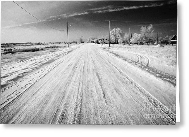 Snow Covered Village Greeting Cards - snow covered road in small rural farming community village Forget Saskatchewan Canada Greeting Card by Joe Fox