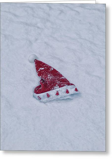 Santa Hat Greeting Cards - snow-covered Santa hat Greeting Card by Joana Kruse