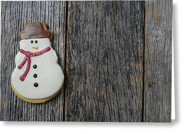 American Food Greeting Cards - Snowman Cookie on Rustic Wood Background for Christmas Greeting Card by Brandon Bourdages