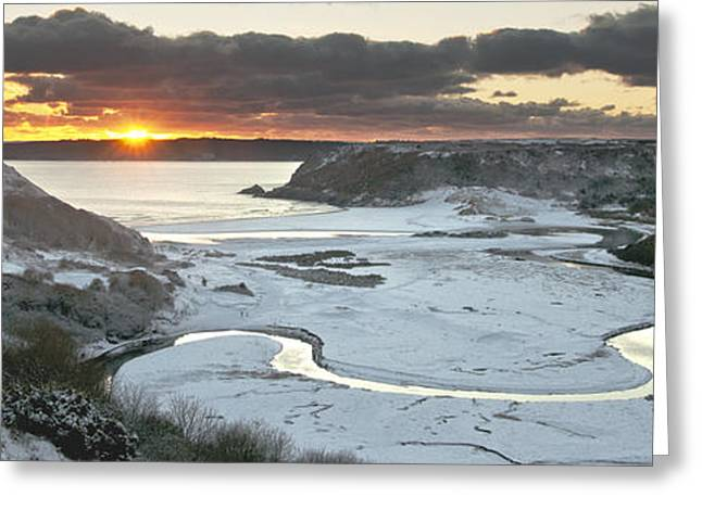 Sand Castles Greeting Cards - Snowy sunset at Three Cliffs Bay Greeting Card by Nigel Forster