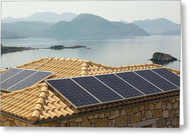 Solar Panels On A House Roof In Sivota Greeting Card by Ashley Cooper