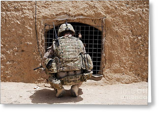 Grate Greeting Cards - Soldier Searches A Compound Greeting Card by Stocktrek Images