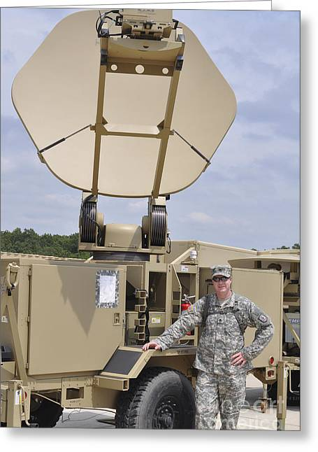 Hand On Waist Greeting Cards - Soldier Stands Next To A Satellite Greeting Card by Stocktrek Images