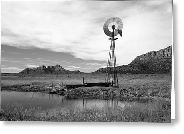 Environmental Conservation Greeting Cards - Solitary Windmill Near A Pond, U.s Greeting Card by Panoramic Images