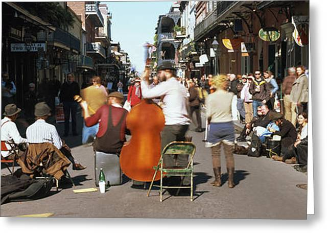 Bourbon Street Greeting Cards - Spectator Looking At Street Musician Greeting Card by Panoramic Images