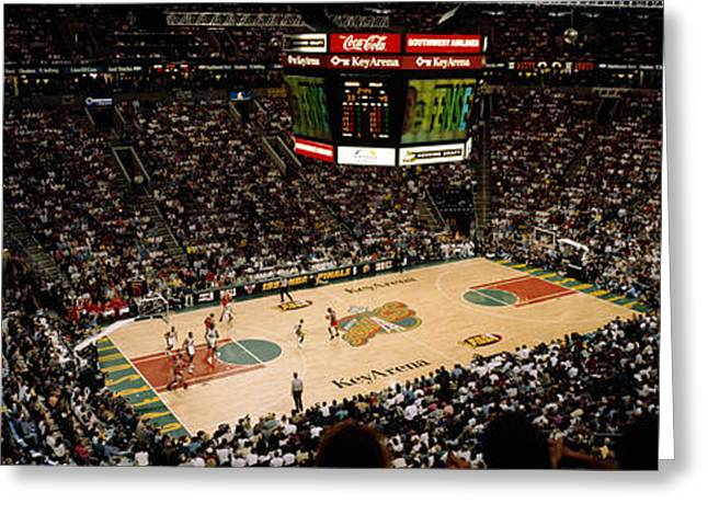 Sport Teams Greeting Cards - Spectators Watching A Basketball Match Greeting Card by Panoramic Images
