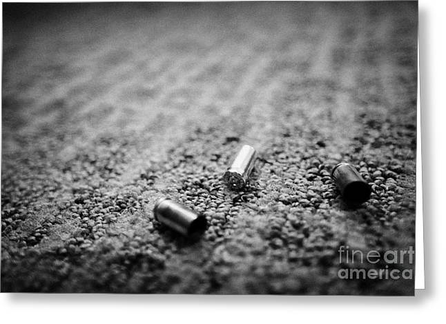 Spend Greeting Cards - Spent 9mm Handgun Bullet Casings Lying On A Hotel Carpet Floor In The Us Greeting Card by Joe Fox