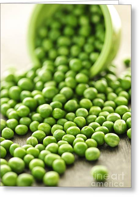 Produce Greeting Cards - Spilled bowl of green peas Greeting Card by Elena Elisseeva