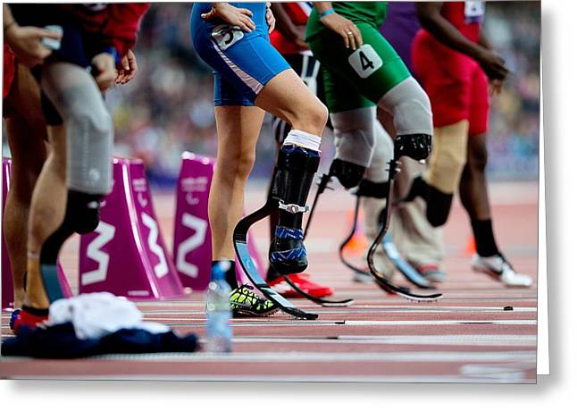 Disability Greeting Cards - Sprinters at start of paralympics 100m Greeting Card by Science Photo Library