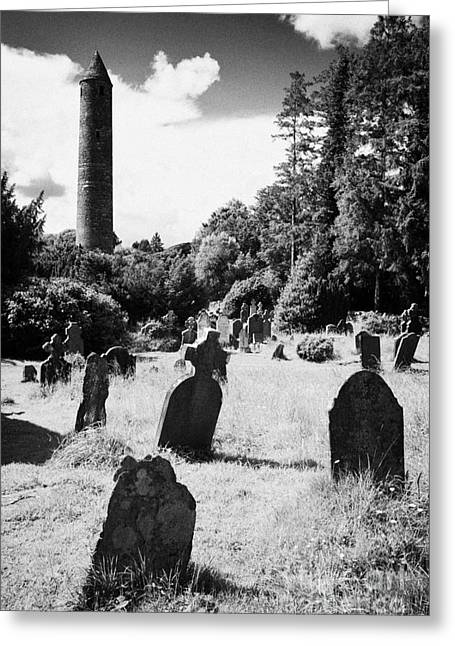 Significance Greeting Cards - St Kevins Round Tower and graveyard at Glendalough monastic site county wicklow ireland Greeting Card by Joe Fox