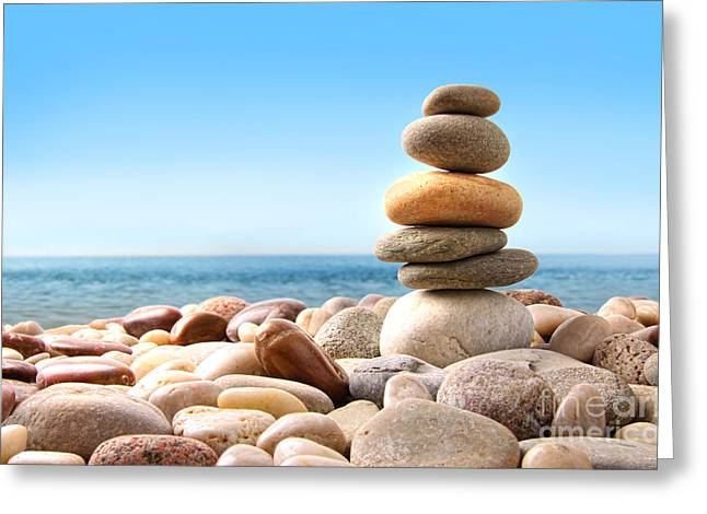 Stack Greeting Cards - Stack of pebble stones on white Greeting Card by Sandra Cunningham