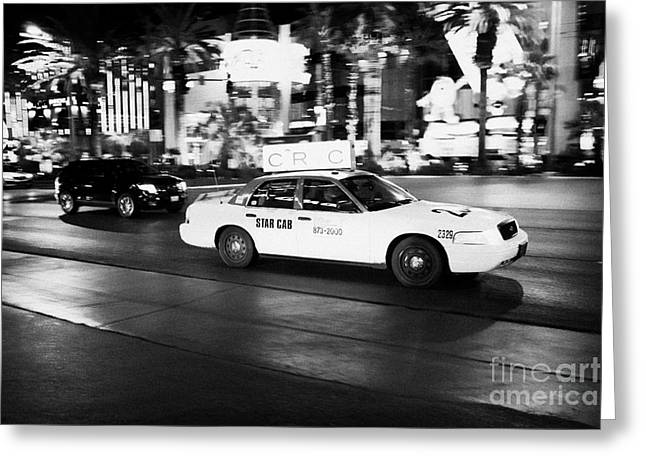 Speeding Taxi Greeting Cards - star cab speeding down Las Vegas boulevard at night Nevada USA deliberate motion blur Greeting Card by Joe Fox