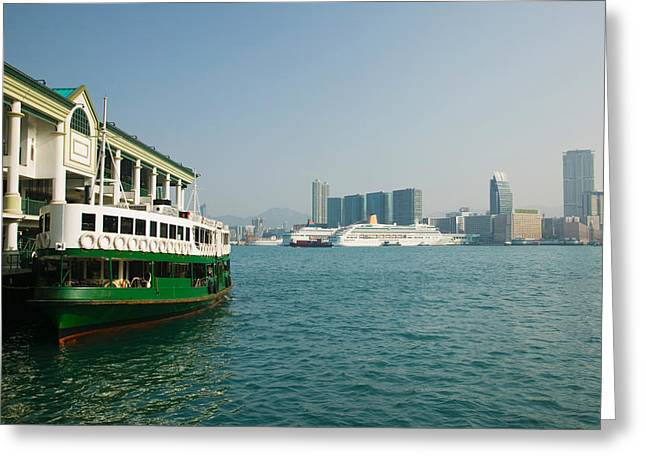 Hong Kong Island Greeting Cards - Star Ferry On A Pier With Buildings Greeting Card by Panoramic Images
