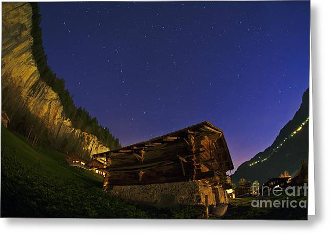 Lauterbrunnen Greeting Cards - Star Trails And A Swiss Chalet Greeting Card by Babak Tafreshi