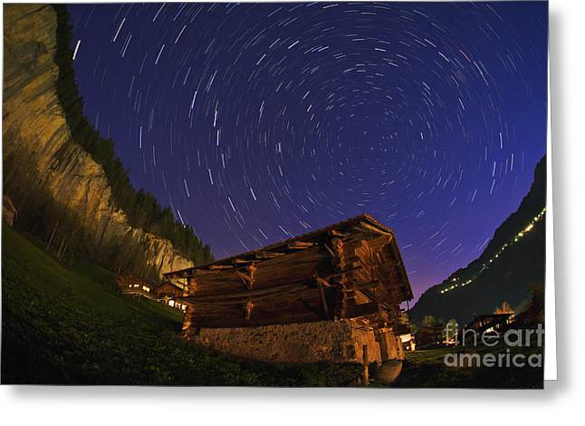 Lauterbrunnen Greeting Cards - Star Trails Over A Swiss Chalet Greeting Card by Babak Tafreshi