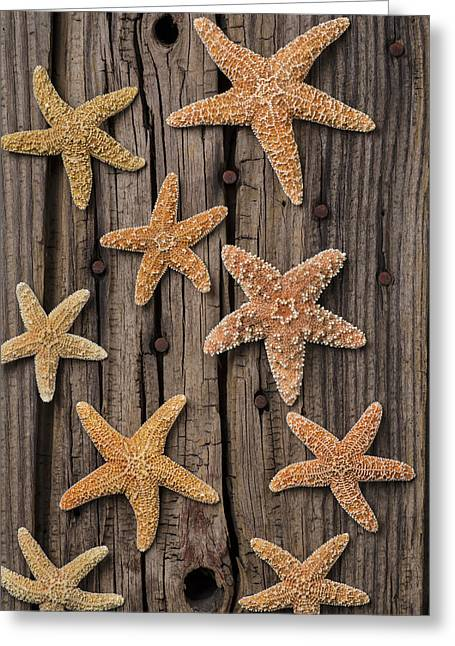 Starfish On Old Wood Greeting Card by Garry Gay
