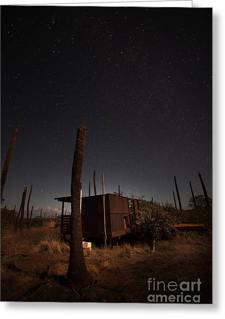 Old Cabins Greeting Cards - Starry Sky Above An Old Cabin Greeting Card by Rogelio Bernal Andreo