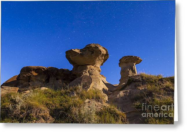 Dinosaur Provincial Park Greeting Cards - Starry Sky Above Hoodoo Formations Greeting Card by Alan Dyer