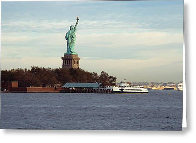 Liberty Island Greeting Cards - Statue On An Island In The Sea, Statue Greeting Card by Panoramic Images