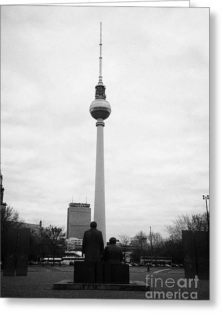 Engels Greeting Cards - statues of Marx and Engels in the Marx Engels Forum looking at the berliner fernsehturm Berlin TV tower symbol of east berlin Germany Greeting Card by Joe Fox