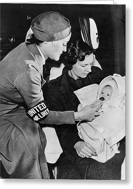 Family With One Child Greeting Cards - Stewardess Feeding Baby Greeting Card by Underwood Archives