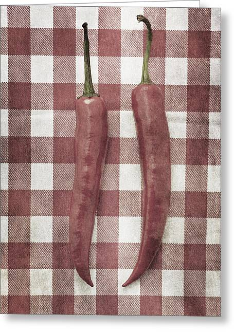 Pairs Greeting Cards - Still life of two red chili peppers Greeting Card by Lars Hallstrom