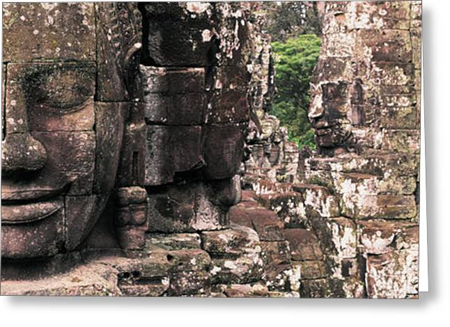 Siem Reap Greeting Cards - Stone Faces Bayon Angkor Siem Reap Greeting Card by Panoramic Images