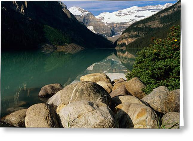 Lake Louise Greeting Cards - Stones At The Lakeside, Lake Louise Greeting Card by Panoramic Images