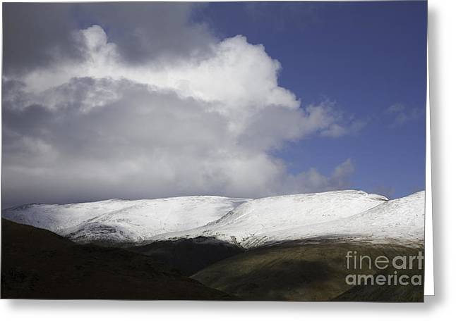 Lion And Lamb Greeting Cards - Storm and shower clouds passing over the snow capped summit of Helvellyn from Helm Crag   Greeting Card by Michael Walters