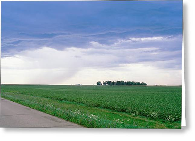 Storm Clouds Greeting Cards - Storm Clouds Over A Landscape Greeting Card by Panoramic Images