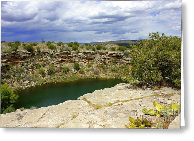 Native American Dwellings Greeting Cards - Storm Clouds over Montezuma Well Greeting Card by Carol Groenen