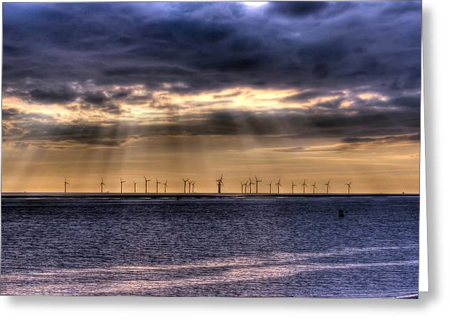 Sea Of Storms Greeting Cards - Storm over the windfarm Greeting Card by Paul Madden