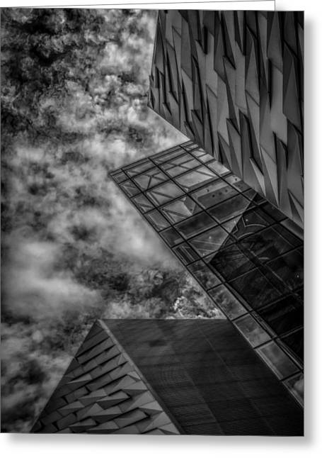 Modern Photographs Greeting Cards - Stormy clouds over modern building Greeting Card by Gareth Burge