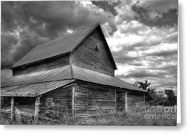 Stormy Clouds Over The Rustic Old Barn Greeting Card by Reid Callaway