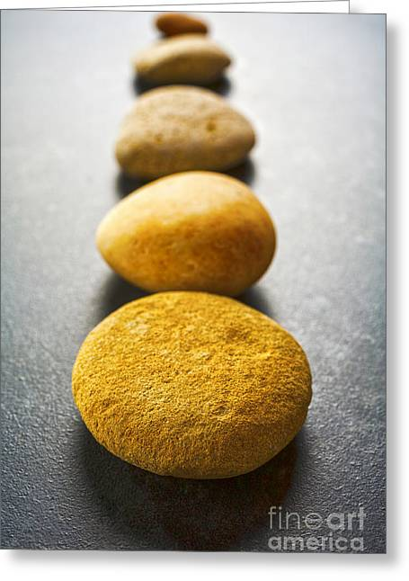 Stepping Stones Greeting Cards - Straight Line of Brown Pebbles on Dark Background Greeting Card by Colin and Linda McKie